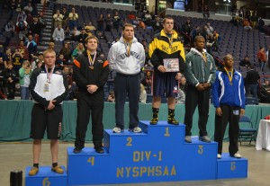 Mills on top of the state school podium.