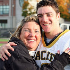 Patti Armine, Class of '80, and her son Angelo, Class of '11.