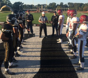A look at the ceremonial coin toss between Sachem East and Sachem North.