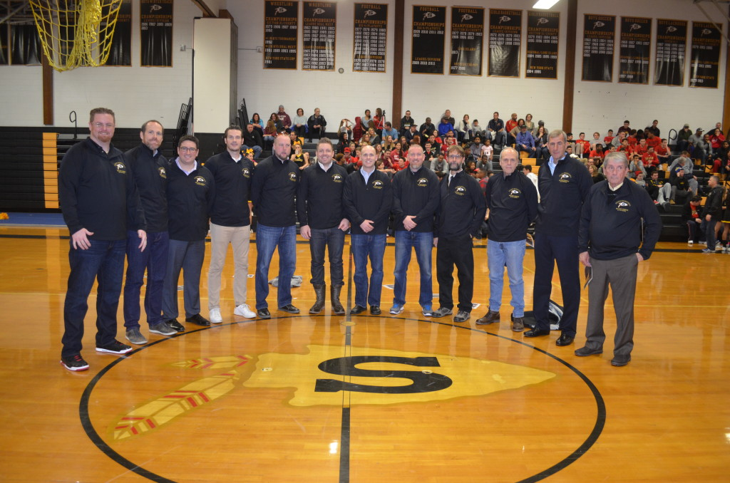 Coaches and players from Sachem's 1995-1996 Suffolk County championship basketball team honored at a 20th anniversary celebration.